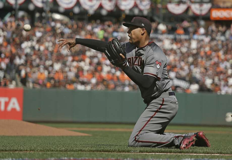 Arizona Diamondbacks starting pitcher Taijuan Walker throws the ball to catcher Jeff Mathis at home plate after the San Francisco Giants' Matt Moore grounded into a fielder's choice in the fourth inning of a baseball game Monday, April 10, 2017, in San Francisco. The Giants' Brandon Crawford scored from third base on the play and Walker was given a throwing error. The Giants scored two other runs following the play and Mathis was given a throwing error. (AP Photo/Eric Risberg) Photo: Eric Risberg, Associated Press