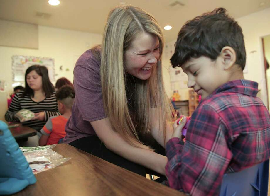 Behavior analyst Holly Bihler works with Micah Rajan, a 5-year-old autism patient, at Texana Center, which supports measures requiring license for analysts.  Photo: Elizabeth Conley, Staff / © 2017 Houston Chronicle