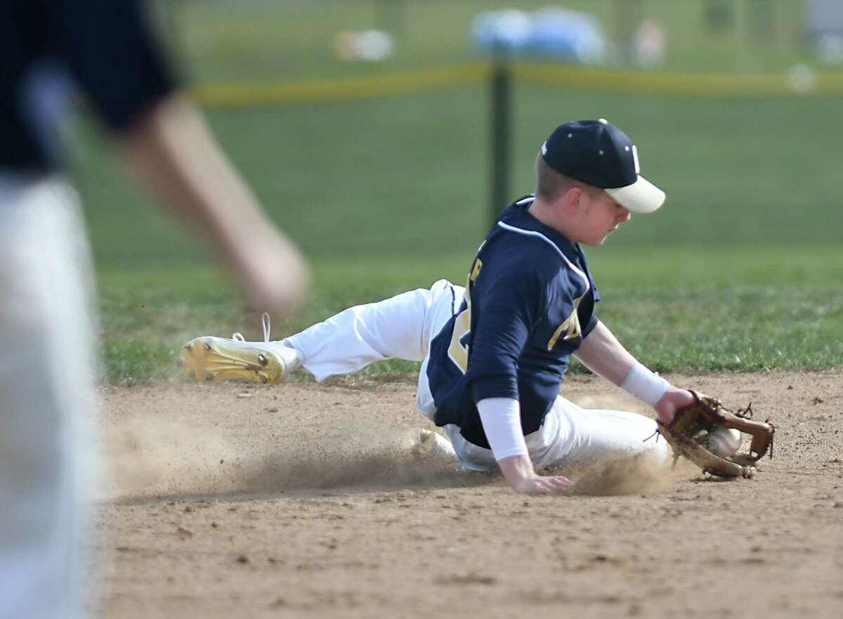 Cohoes shortstop Derek Becker grabs a shot up the middle during a baseball game against Voorheesville on Monday, April 10, 2017 in Voorheesville, N.Y. (Lori Van Buren / Times Union)