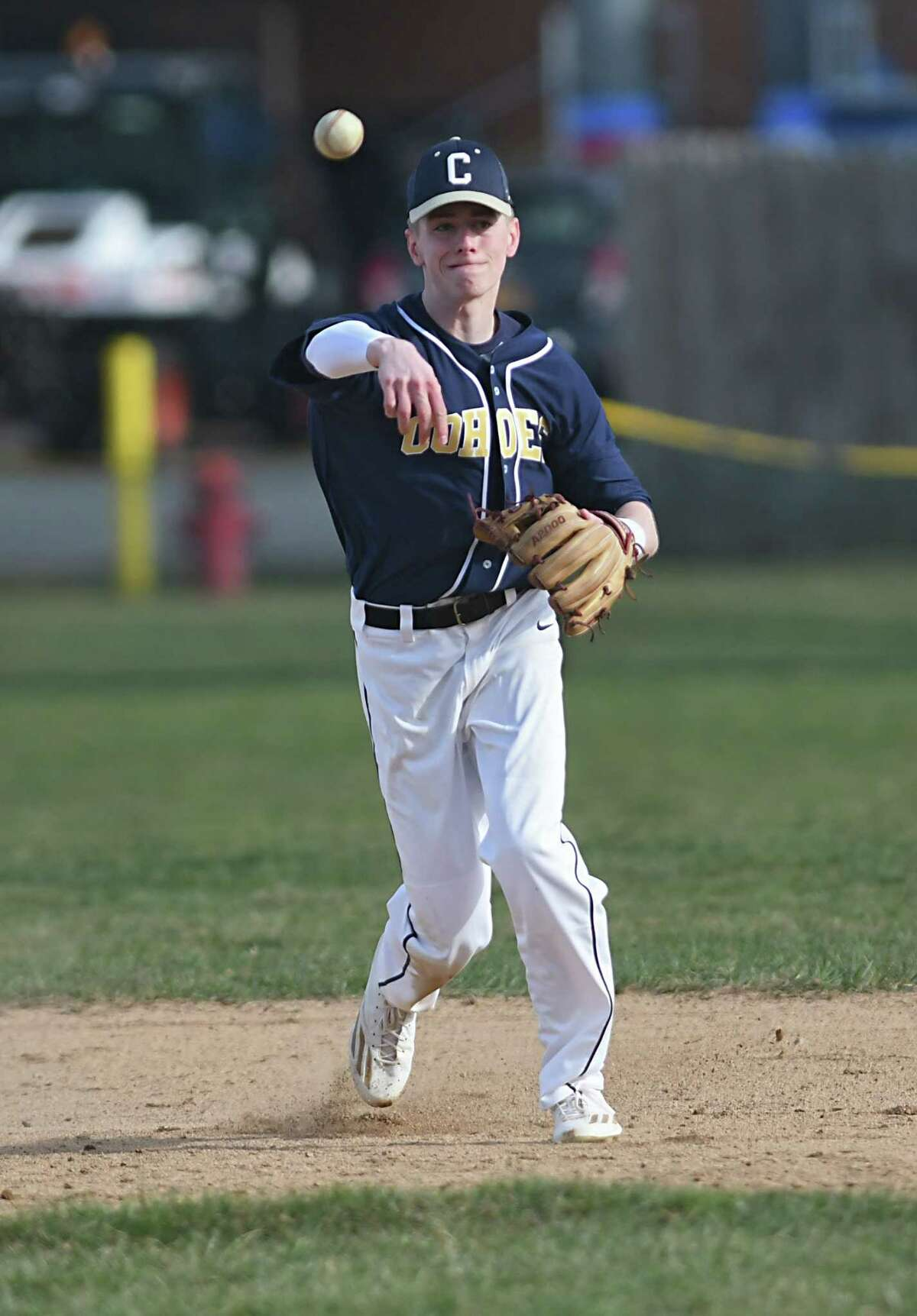 Cohoes shortstop Derek Becker throws the ball to first base during a baseball game against Voorheesville on Monday, April 10, 2017 in Voorheesville, N.Y. (Lori Van Buren / Times Union)