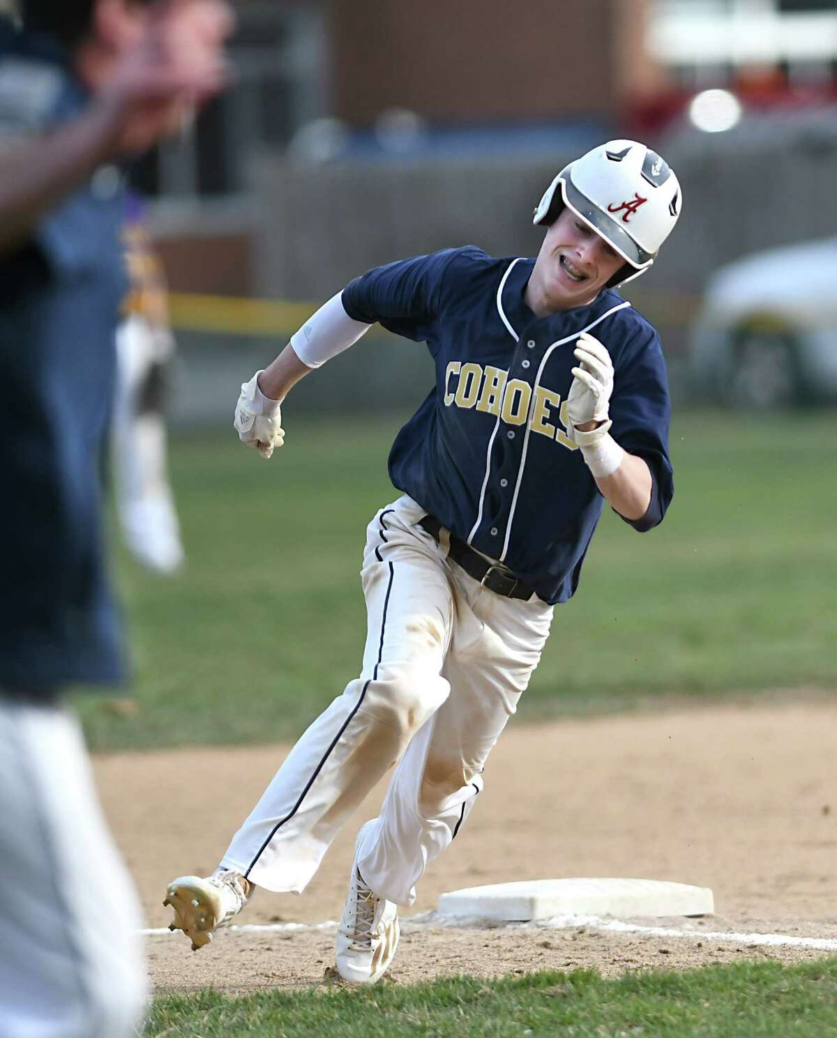 Cohoes shortstop Derek Becker rounds third as the third base coach motions him to run home during a baseball game against Voorheesville on Monday, April 10, 2017 in Voorheesville, N.Y. Becker was safe at home. (Lori Van Buren / Times Union)