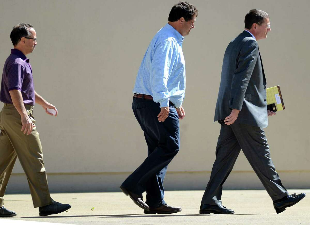 Joseph Gerardi, left, and Steven Aiello, center, both of COR Development Co., walk from the Federal Building in downtown Syracuse, N.Y., Thursday, Sept. 22, 2016. The men face federal corruption charges in U.S. Attorney Preet Bharara's investigation into economic development projects in Upstate New York. Aiello and Gerardi are accused of bribing a former top aide to Gov. Andrew Cuomo. Michael Greenlar /The Syracuse Newspapers via AP)