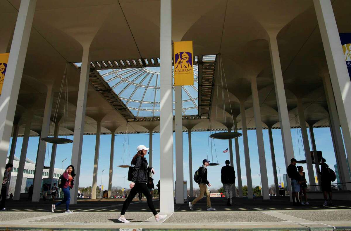 University at Albany students make their way between classes on Monday, April 10, 2017, in Albany, N.Y. (Paul Buckowski / Times Union)