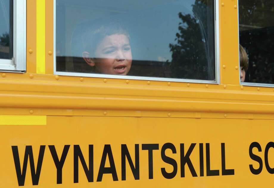 Anthony Vazzana, 4, of Wynantskill looks out the window at his mom and cries a little as kindergarten students take a test ride on a school bus at Gardner-Dickinson School on Tuesday, Sept. 2, 2014 in North Greenbush, N.Y. The Wynantskill School District will lose state aide in 2017-2018. (Lori Van Buren / Times Union) Photo: Lori Van Buren / 00028410A