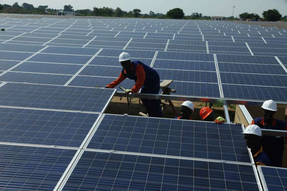 Wood Mackenzie believes major oil companies will shift more of their money into solar panels. Photo: Stephen Wandera, STR / Copyright 2016 The Associated Press. All rights reserved. This material may not be published, broadcast, rewritten or redistribu