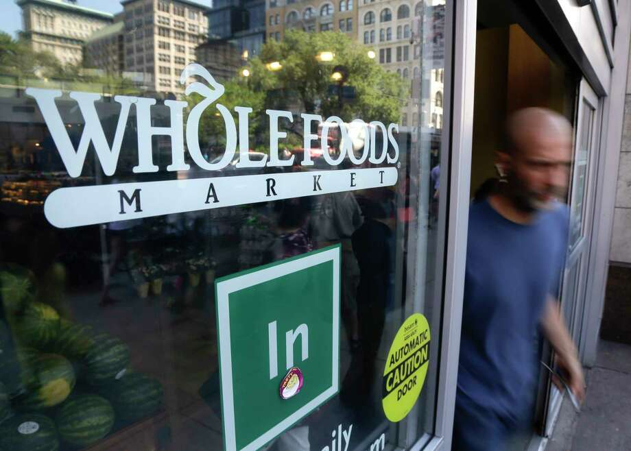 FILE - In this June 24, 2015, file photo, a shopper leaves a Whole Foods Market store in New York's Union Square. Whole Foods reports financial results Wednesday, July 27, 2016. (AP Photo/Julie Jacobson, File) Photo: Julie Jacobson, STF / Copyright 2016 The Associated Press. All rights reserved. This material may not be published, broadcast, rewritten or redistribu