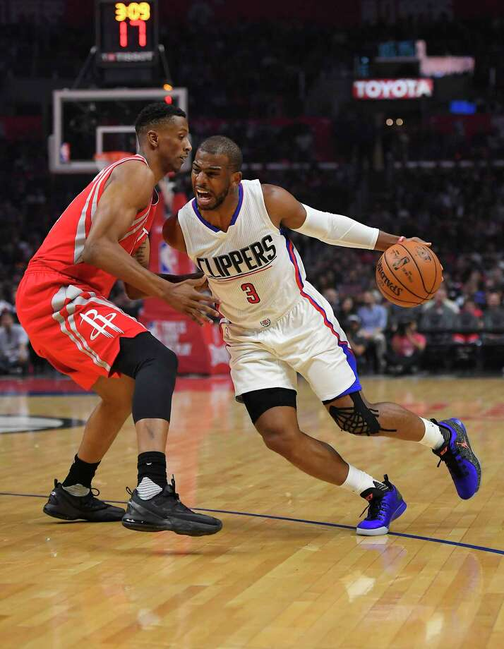 Los Angeles Clippers guard Chris Paul, right, tries to drive past Houston Rockets forward Troy Williams during the first half of an NBA basketball game, Monday, April 10, 2017, in Los Angeles. (AP Photo/Mark J. Terrill) Photo: Mark J. Terrill, Associated Press / Copyright 2017 The Associated Press. All rights reserved.