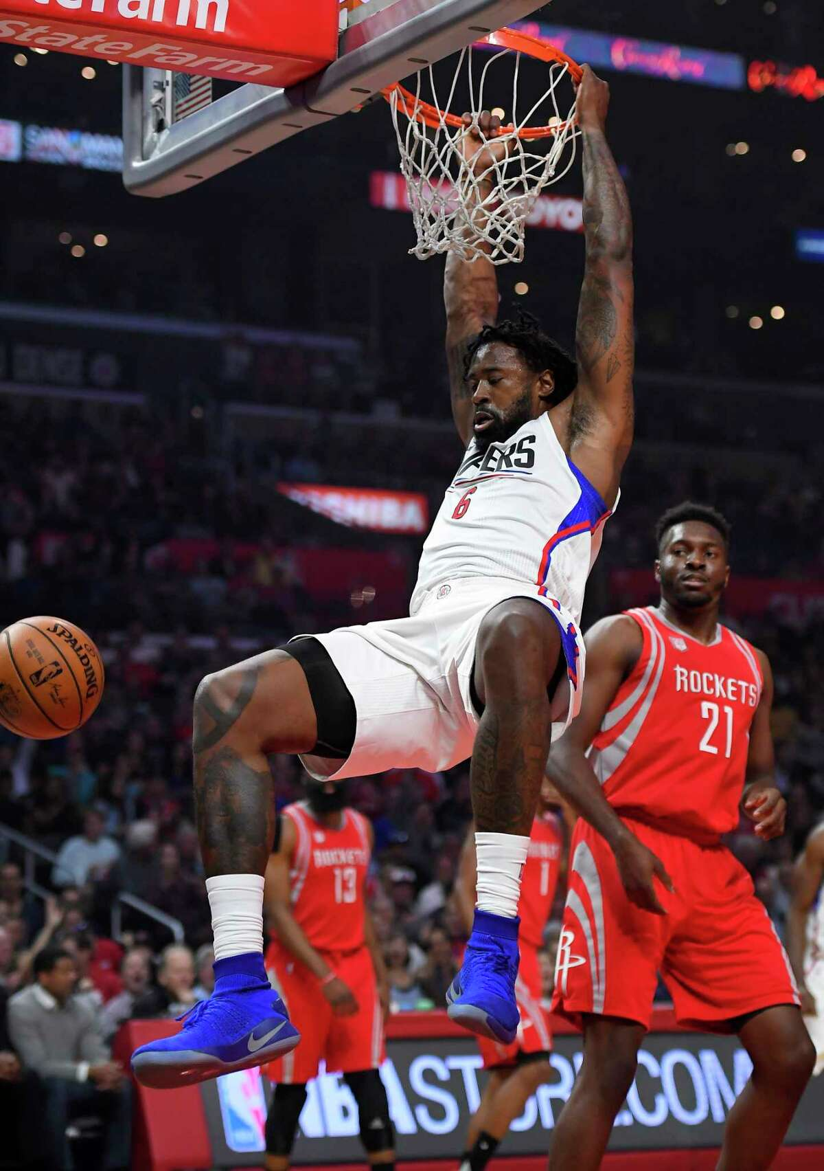 Los Angeles Clippers center DeAndre Jordan, left, dunks as Houston Rockets forward Chinanu Onuaku watches during the first half of an NBA basketball game, Monday, April 10, 2017, in Los Angeles. (AP Photo/Mark J. Terrill)