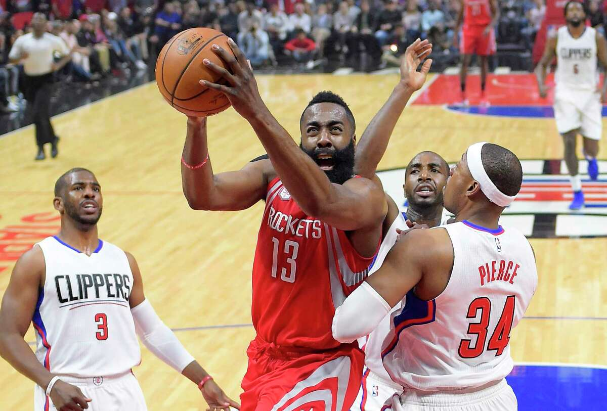 Houston Rockets guard James Harden, second from left, shoots as Los Angeles Clippers guard Chris Paul, left, forward Luc Mbah a Moute, second from right, of Cameroon, and forward Paul Pierce defend during the first half of an NBA basketball game, Monday, April 10, 2017, in Los Angeles. (AP Photo/Mark J. Terrill)