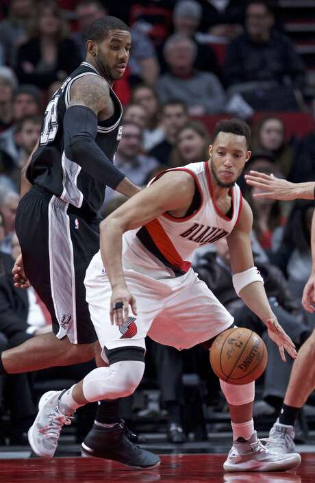 Portland Trail Blazers guard Evan Turner, right, dribbles around San Antonio Spurs forward LaMarcus Aldridge during the second half of an NBA basketball game in Portland, Ore., Monday, April 10, 2017. (AP Photo/Craig Mitchelldyer) Photo: Craig Mitchelldyer/Associated Press