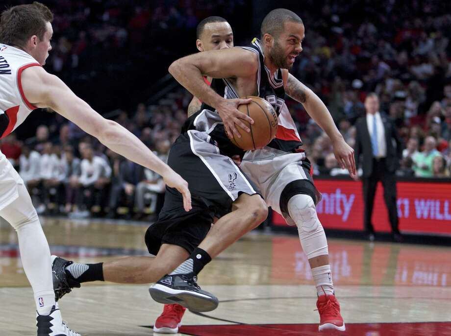 San Antonio Spurs guard Tony Parker, center, drives past Portland Trail Blazers guard Shabazz Napier, right, and guard Pat Connaughton, left, during the second half of an NBA basketball game in Portland, Ore., Monday, April 10, 2017. (AP Photo/Craig Mitchelldyer) Photo: Craig Mitchelldyer, FRE / Associated Press / FR170751 AP