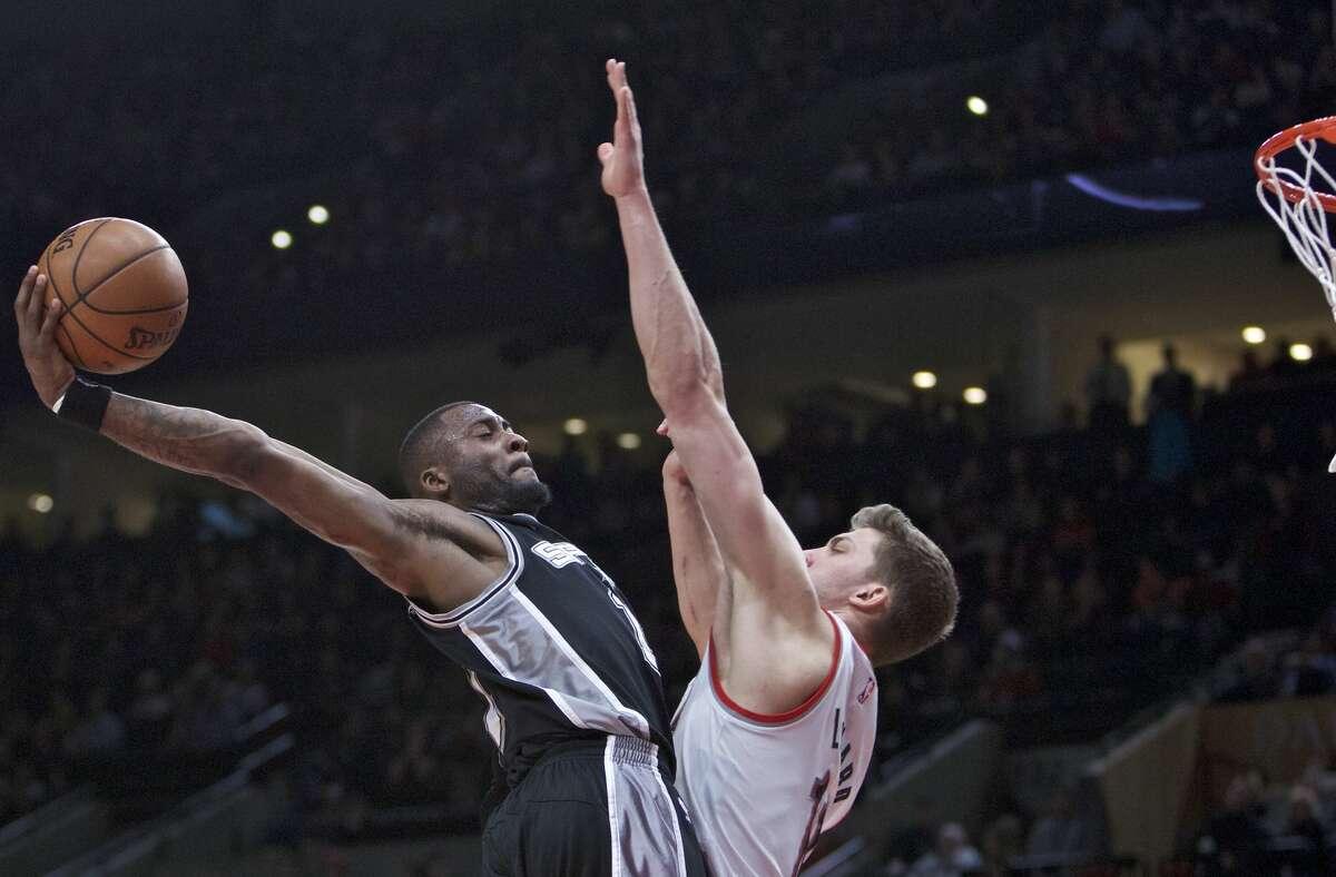 San Antonio Spurs guard Jonathon Simmons dunks over Portland Trail Blazers forward Meyers Leonard during the second half of an NBA basketball game in Portland, Ore., Monday, April 10, 2017. The Trail Blazers won 99-98. (AP Photo/Craig Mitchelldyer)