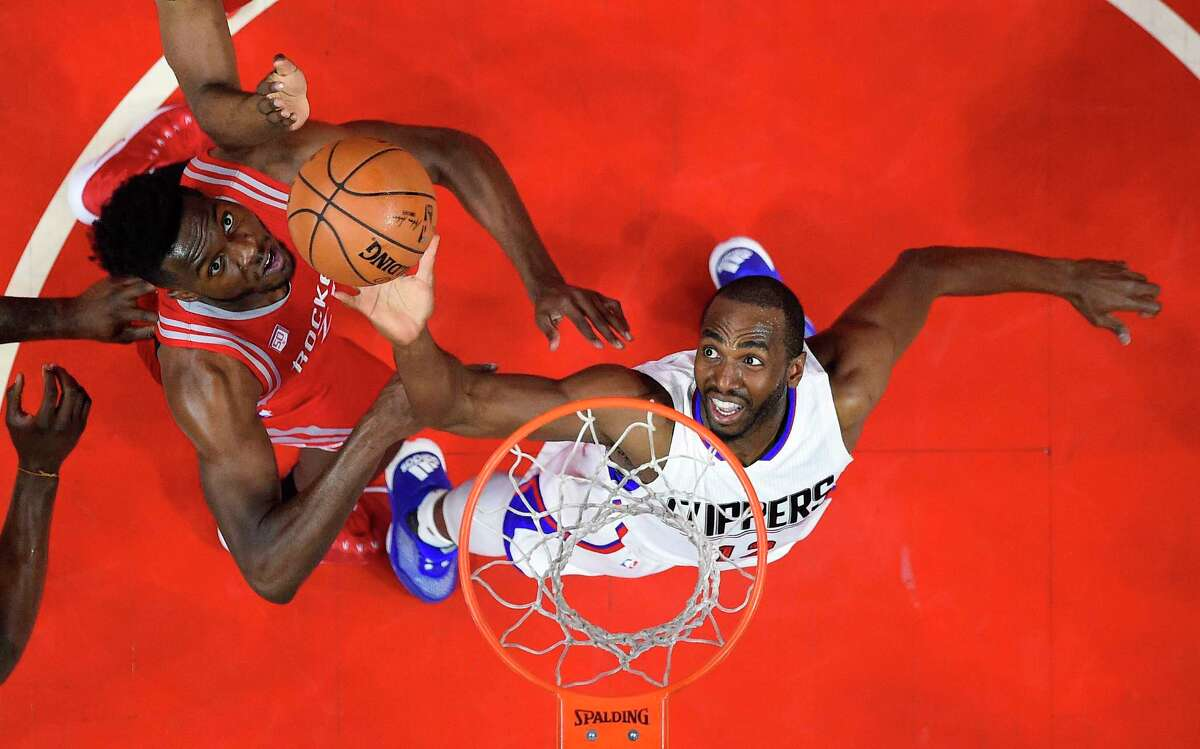 Los Angeles Clippers forward Luc Mbah a Moute, of Cameroon, shoots as Houston Rockets forward Chinanu Onuaku defends during the first half of an NBA basketball game, Monday, April 10, 2017, in Los Angeles. (AP Photo/Mark J. Terrill)