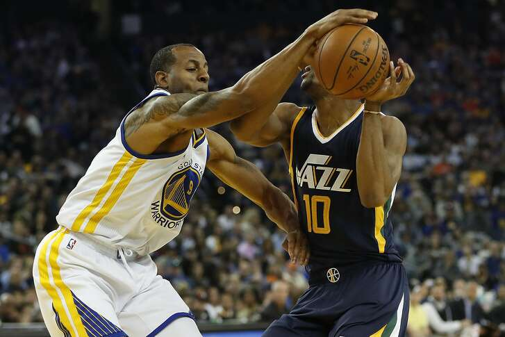 Andre Iguodala (9) of the Golden State Warriors strips the ball from Alec Burks (10) of the Utah Jazz during the second quarter of their NBA basketball game at Oracle Arena in Oakland, Calif. on Monday, April 10, 2017. The Jazz defeated the Warriors 105-99.