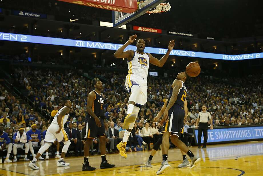 Kevin Durant (35) of the Golden State Warriors reacts after making a dunk during the third quarter of his NBA basketball game against the Utah Jazz at Oracle Arena in Oakland, Calif. on Monday, April 10, 2017. The Jazz defeated the Warriors 105-99. Photo: Stephen Lam, Special To The Chronicle