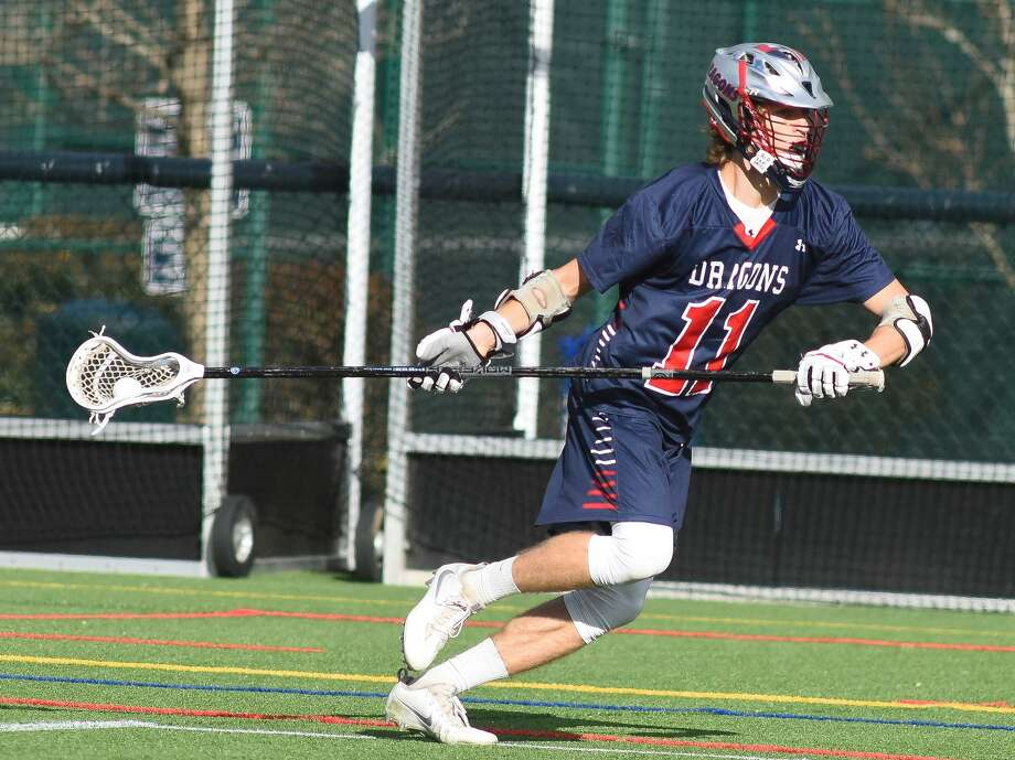 Greens Farms Academy senior defender Henry Elkind of Westport takes the ball downfield in his team's game against Wilbraham & Monson in the boys lacrosse season opener Wednesday, April 5. Photo: Contributed / Photo