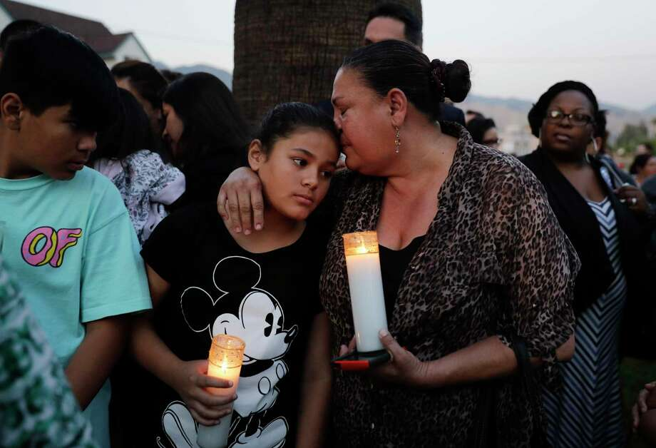 Betty Rodriguez, right, comforts her granddaughter Giselle during a prayer service held to honor the shooting victims at North Park Elementary School, Monday, April 10, 2017, in San Bernardino, Calif. A man walked into his estranged wife's elementary school classroom in San Bernardino and opened fire on Monday. Photo: Jae C. Hong, AP / Copyright 2017 The Associated Press. All rights reserved.