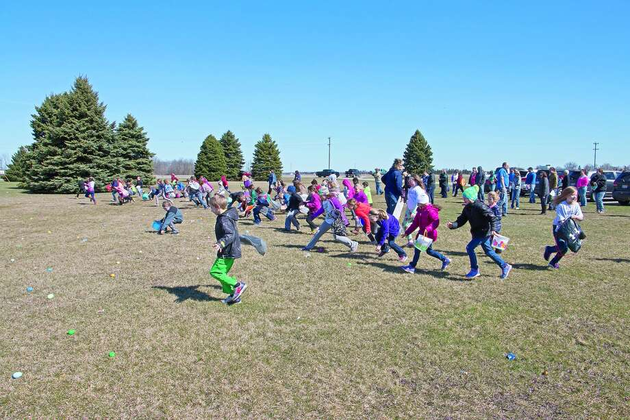 An avid group of 7- to 9-year-olds run for eggs at one of the hunts hosted Saturday by the Bad Axe Free Methodist Church. Photo: Bill Diller/For The Tribune