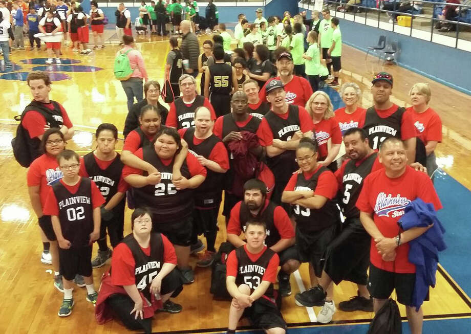 The Plainview Stars had two teams competing March 25 at the Area 17 Special Olympics Basketball Tournament at Frenship. Representing the Plainview Stars were Ryan Ethridge (front left), Jimmy Sungia, Joshua Mooney (second row left), Kami Holbert, Paul Lopez, Marissa Enriquez (third row left), Raymond Quintanilla, Lorraine Barrientos, Polly Gomez, Abraham Martinez, Joshua Armstrong (fourth row left), Donnicia Bremby, Tracy Poole, Danny Potts, Lynn Mason, Jackie Ball, Donnie Matsler, Stephanie Holbert (fifth row left), Ronnie Price, Jared Ball, Janet Poole, Kathy Ethridge and coach Ricky Mason (back row).