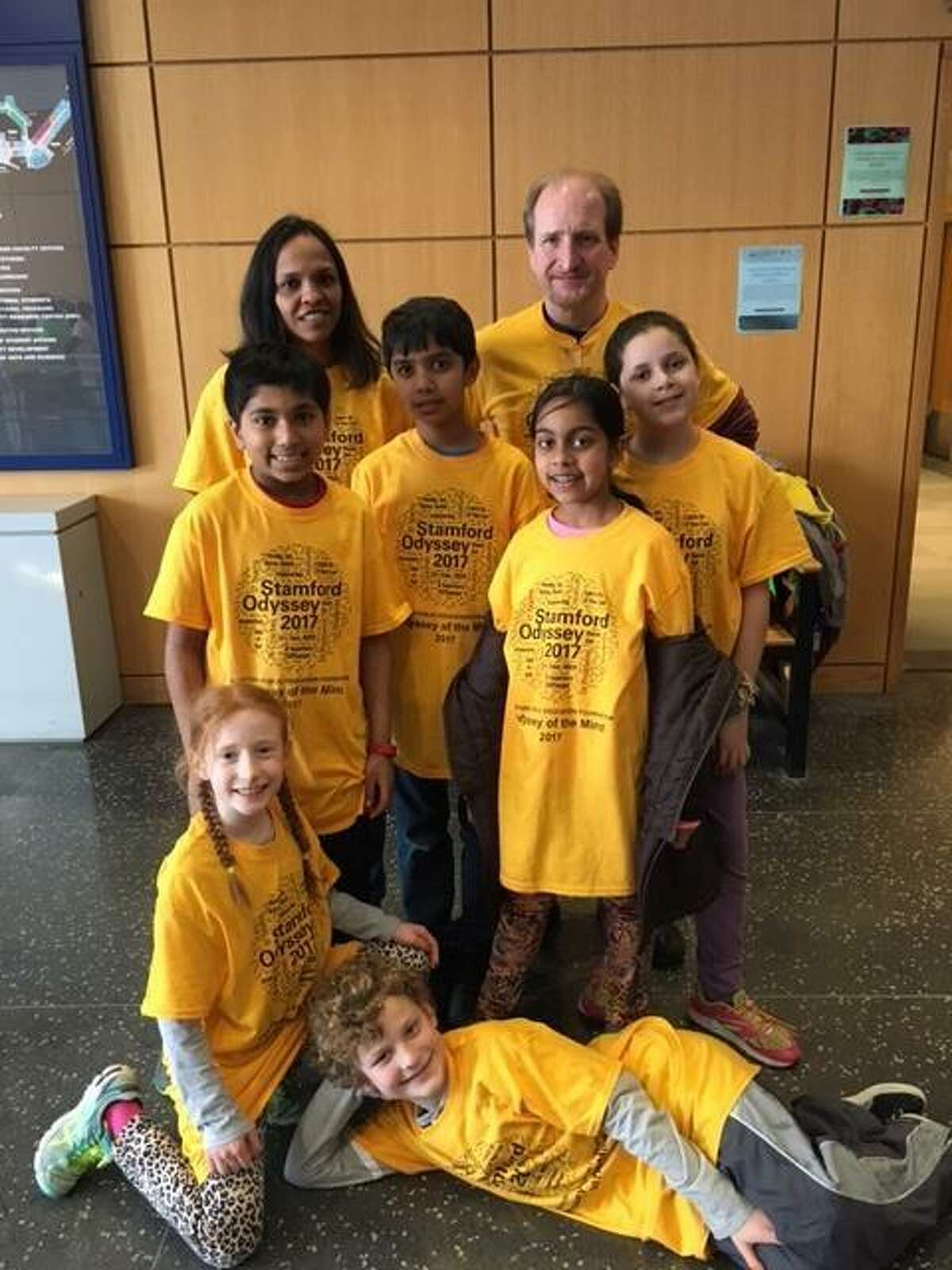 From left, coaches Rajni Chidambaram and Glenn Harper pose for a picture with Newfield Elementary School students Veeraj Shah Sidhanth Pharshy, Ananya Gupta and Riley Allyn in the second row and Alanna Harper and Wyatt Elsner in the front row during the Odyssey of the Mind statewide tournament at Southern Connecticut State University in New Haven, Conn., on March 18, 2017.