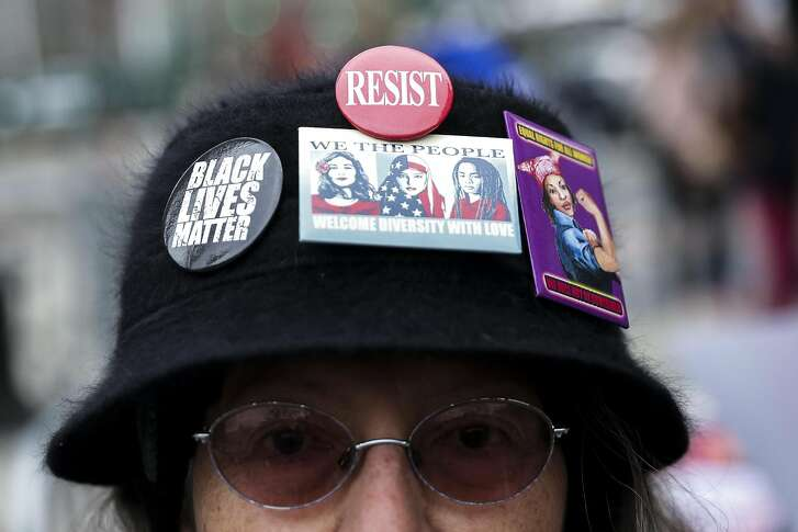 A demonstrator wears a hat with protest buttons during The People's Filibuster rally at Foley Square in New York, U.S., on Saturday, April 1, 2017. The People's Filibuster is a nation wide rally in objection to U.S. President Donald Trump's agenda and his appointment of Judge Neil Gorsuch to the Supreme Court. Photographer: Jeenah Moon/Bloomberg