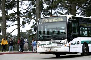 Skyline High students arrive by AC Transit bus for a day of classes at the school in Oakland, Calif. on Tuesday, April 11, 2017. The Oakland Unified School District and the transit agency are trying to come up with a solution to continue the school bus service after the district was forced to halt funding the direct service.