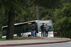 An AC Transit bus transporting Skyline High School students drives up the hill to the campus in Oakland, Calif. on Tuesday, April 11, 2017. The Oakland Unified School District and the transit agency are trying to come up with a solution to continue the school bus service after the district was forced to halt funding the direct service.