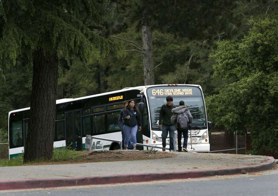 An AC Transit bus transporting Skyline High School students drives up the hill to the campus in Oakland, Calif. on Tuesday, April 11, 2017. The Oakland Unified School District and the transit agency are trying to come up with a solution to continue the school bus service after the district was forced to halt funding the direct service. Photo: Paul Chinn, The Chronicle