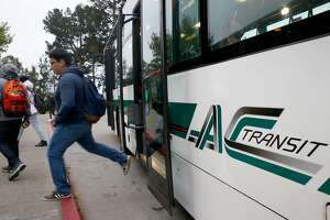 Skyline High students hop off an AC Transit bus for a day of classes at the school in Oakland, Calif. on Tuesday, April 11, 2017. The Oakland Unified School District and the transit agency are trying to come up with a solution to continue the school bus service after the district was forced to halt funding the direct service.