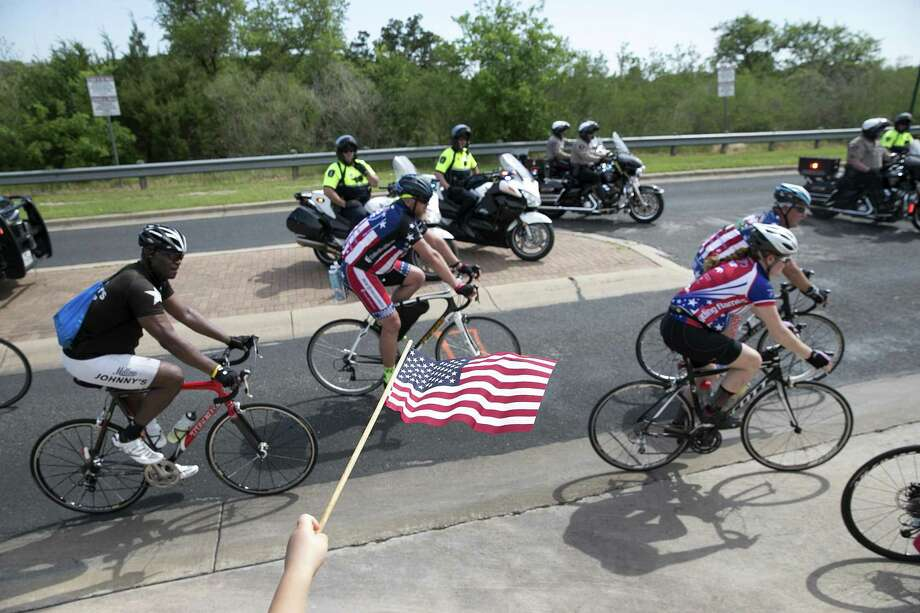 "Cyclists with Project Hero's Texas Challenge roll into their stop in Georgetown, Texas on Tuesday, April 4, 2017. The 2017 ""Texas Challenge,"" benefits the injured military veteran riders of Project Hero. The ride is a non-competitive, therapeutic bike tour that travels from San Antonio to Houston with stops throughout central Texas during the six day ride. Project Hero is a national nonprofit organization that helps veterans and first responders affected by injury, post-traumatic stress disorder and traumatic brain injury achieve rehabilitation, recovery and resilience in their daily lives. (Deborah Cannon/Austin American-Statesman via AP) Photo: Deborah Cannon, MBO / Associated Press / Austin American-Statesman"