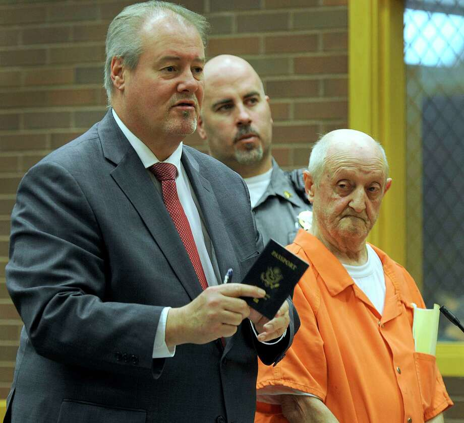Attorney Edward Gavin representing William Trefzger, shows Tefzger's passport to the judge at a bond hearing at state Superior Court in Danbury, Tuesday, April 11, 2017.  Trefzger was recently charged in connection to a local sex trafficking ring. Photo: Carol Kaliff, Hearst Connecticut Media / The News-Times