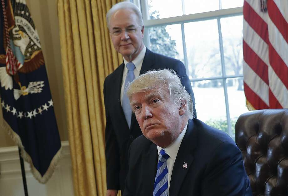 """FILE - In this March 24, 2017 file photo, President Donald Trump with Health and Human Services Secretary Tom Price are seen in the Oval Office of the White House in Washington. With prospects in doubt for repealing """"Obamacare,"""" some Republicans say the Trump administration can rewrite regulations and take other actions to undo much of the health care law on its own. (AP Photo/Pablo Martinez Monsivais, File) Photo: Pablo Martinez Monsivais, Associated Press"""