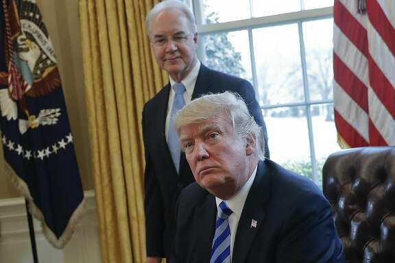 FILE - In this March 24, 2017 file photo, President Donald Trump with Health and Human Services Secretary Tom Price are seen in the Oval Office of the White House in Washington. With prospects in doubt for repealing �Obamacare,� some Republicans say the Trump administration can rewrite regulations and take other actions to undo much of the health care law on its own. (AP Photo/Pablo Martinez Monsivais, File)