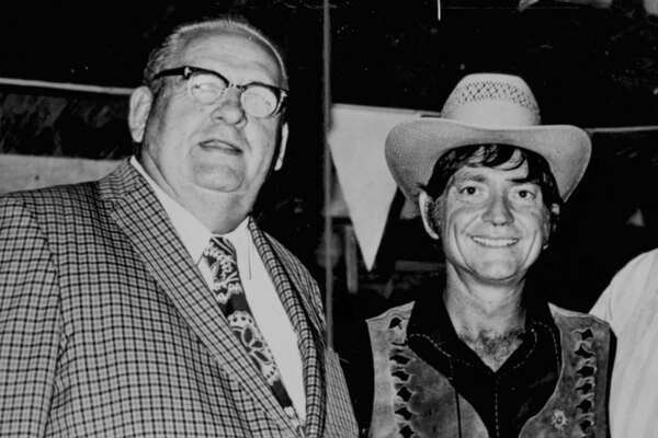 John T. Floore (left) and Willie Nelson in the 1970s
