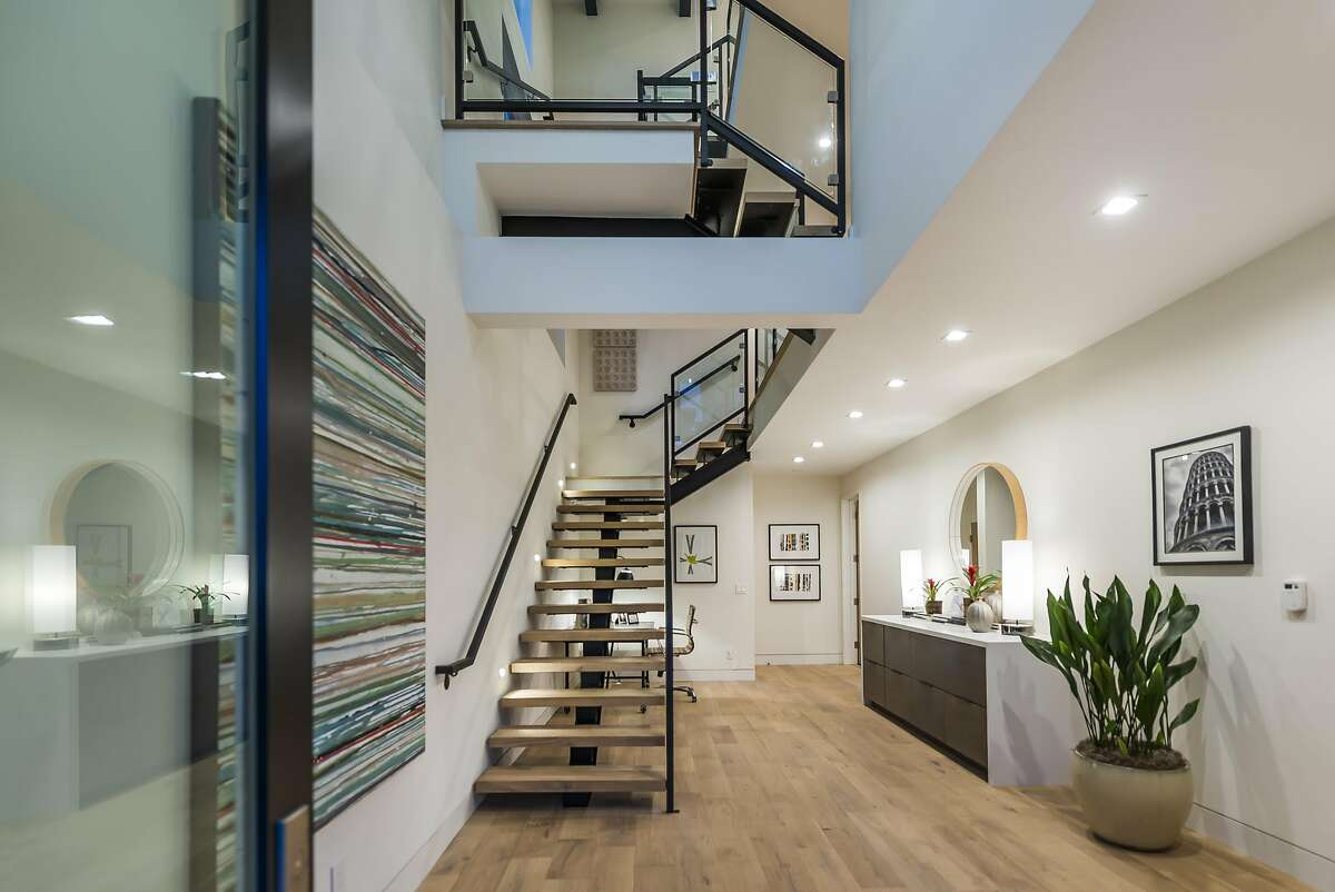 The entry foyer hosts the turned staircase that connects all four levels.�