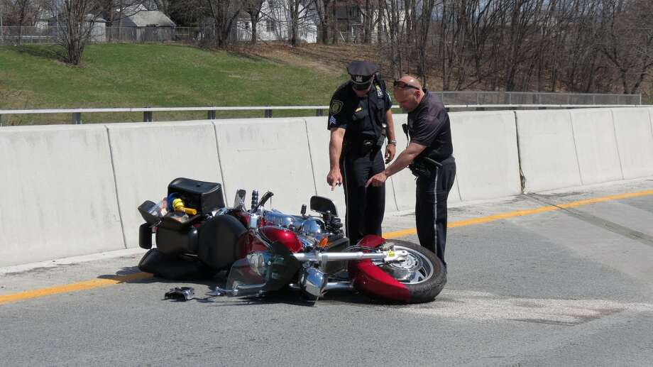 Albany police investigate a motorcycle crash on the northbound side of Interstate 787 on Tuesday. The crash left a 63-year-old man badly injured. Photo: Tom Heffernan Sr. / Special To The Times Union