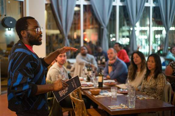 Tunde Wey addresses diners at his Blackness in America dinner at El Buen Comer in San Francisco, Calif. on Monday, April 11, 2017. Chef-activist Tunde Wey brings diners together to tackle issues like racism and immigration.
