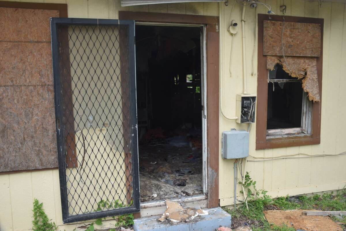 A fire at an abandoned home on Tuesday, April 11, 2017, is believed to have begun on a mattress inside the building, leading investigators to believe someone was living inside.