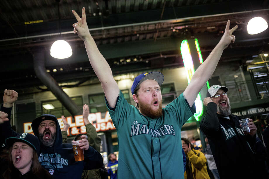 Fans explode as the Mariners score in the fifth inning during their 2017 home opener against the Houston Astros on Monday, April 10, 2017. Photo: GRANT HINDSLEY, SEATTLEPI.COM / SEATTLEPI.COM