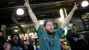 Fans explode as the Mariners score in the fifth inning during their 2017 home opener against the Houston Astros on Monday, April 10, 2017.