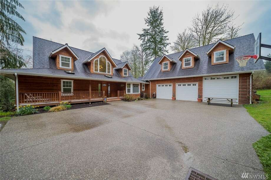 You can enjoy all the joys of PNW living in this 2+ acre home, which boasts floor-to-ceiling windows, skylights, and in-floor heat. Couple that with the stone fireplace and covered wrap around deck and this house is sure to bring comfort and warmth to any occupant. 