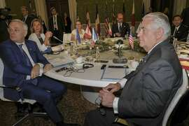Clockwise from left, France Foreign Minister Jean-Marc Ayrault, European Union for Foreign Affairs and Security Policy Federica Mogherini, Canadian Foreign Minister Chrystia Freeland, Italian Foreign Minister Angelino Alfano, Japanese Foreign Minister Fumio Kishida and US Secretary of State Rex Tillerson, sit at the table during a meeting of foreign ministers of the G7 in Lucca, Italy, Tuesday, April 11, 2017. Foreign ministers from the Group of Seven industrialized nations are expected to call for a new international push to end the war in Syria as they end a meeting in Italy Tuesday.  (Riccardo Dalle Luche/ANSA via AP)
