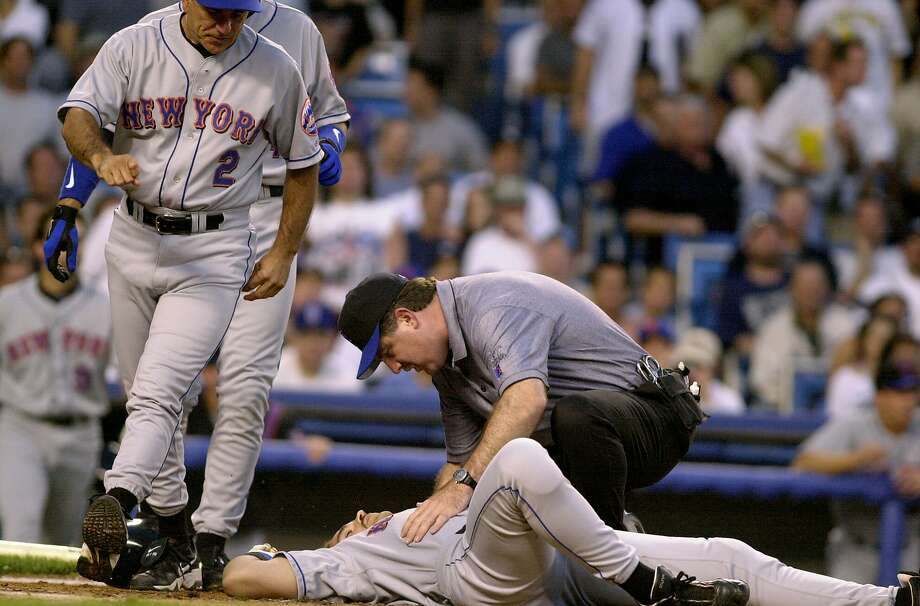 UNITED STATES - CIRCA 2000:  New York Mets' Mike Piazza gets knocked to the ground after pitch by Roger Clemens struck him on the head during game against the New York Yankees. Piazza was taken to the hospital for tests as the Yankees went on to win game 2 of the subway series double header, 4-2.  (Photo by Todd Maisel/NY Daily News Archive via Getty Images) Photo: New York Daily News Archive, NY Daily News Via Getty Images