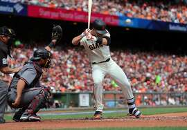 Giants' Buster Posey flinches before being hit iby a pitch by Arizona's Taijuan Walker in the first inning, as the San Francisco Giants take on the Arizona Diamondbacks in their home opener against the at AT&T Park in San Francisco, Calif. on Mon. April 10, 2017.