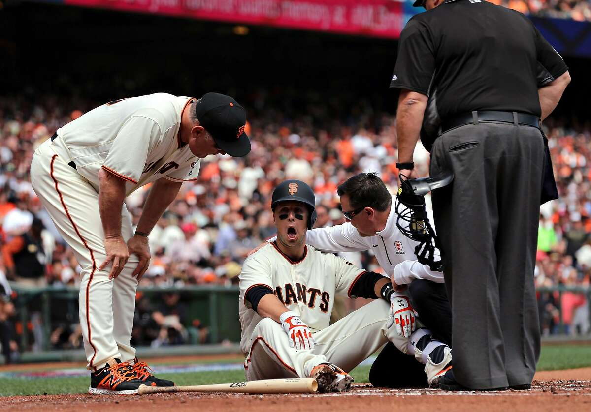 Giants' Buster Posey goes down after being hit by a pitch by Arizona's Taijuan Walker in the first inning, as the San Francisco Giants take on the Arizona Diamondbacks in their home opener against the at AT&T Park in San Francisco, Calif. on Mon. April 10, 2017.