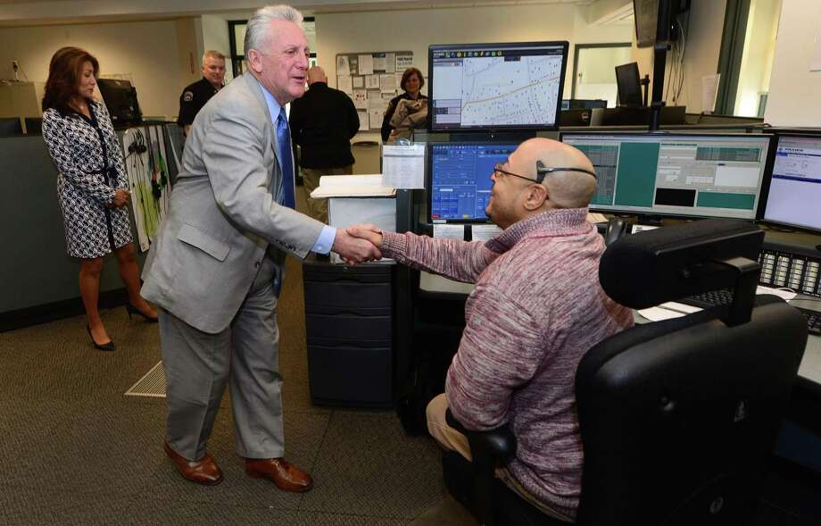 Norwalk Mayor Rilling thanks dispatcher Eric Giddiens after reading a proclamation in recognition of National Public Safety Telecommunications Week on Tuesday. Photo: Erik Trautmann / Hearst Connecticut Media / Norwalk Hour