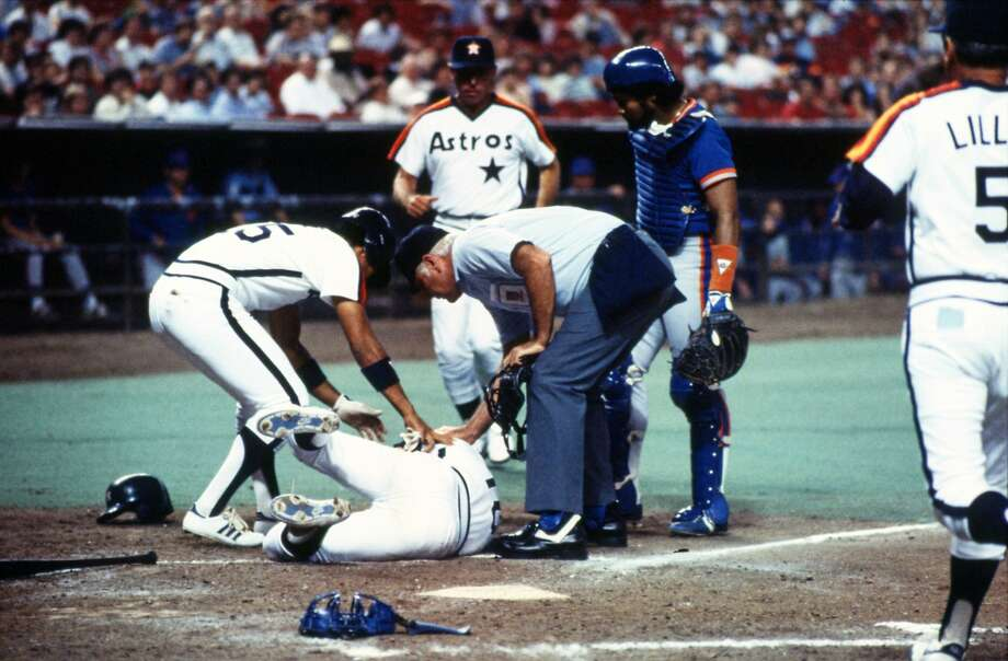 04/08/1984 - Astros Dickie Thon lays writhing in pain at home plate in the Astrodome after being hit in the left eye by a pitch from New York Mets Mike Torrez. Photo: Geary G. Broadnax, Houston Chronicle