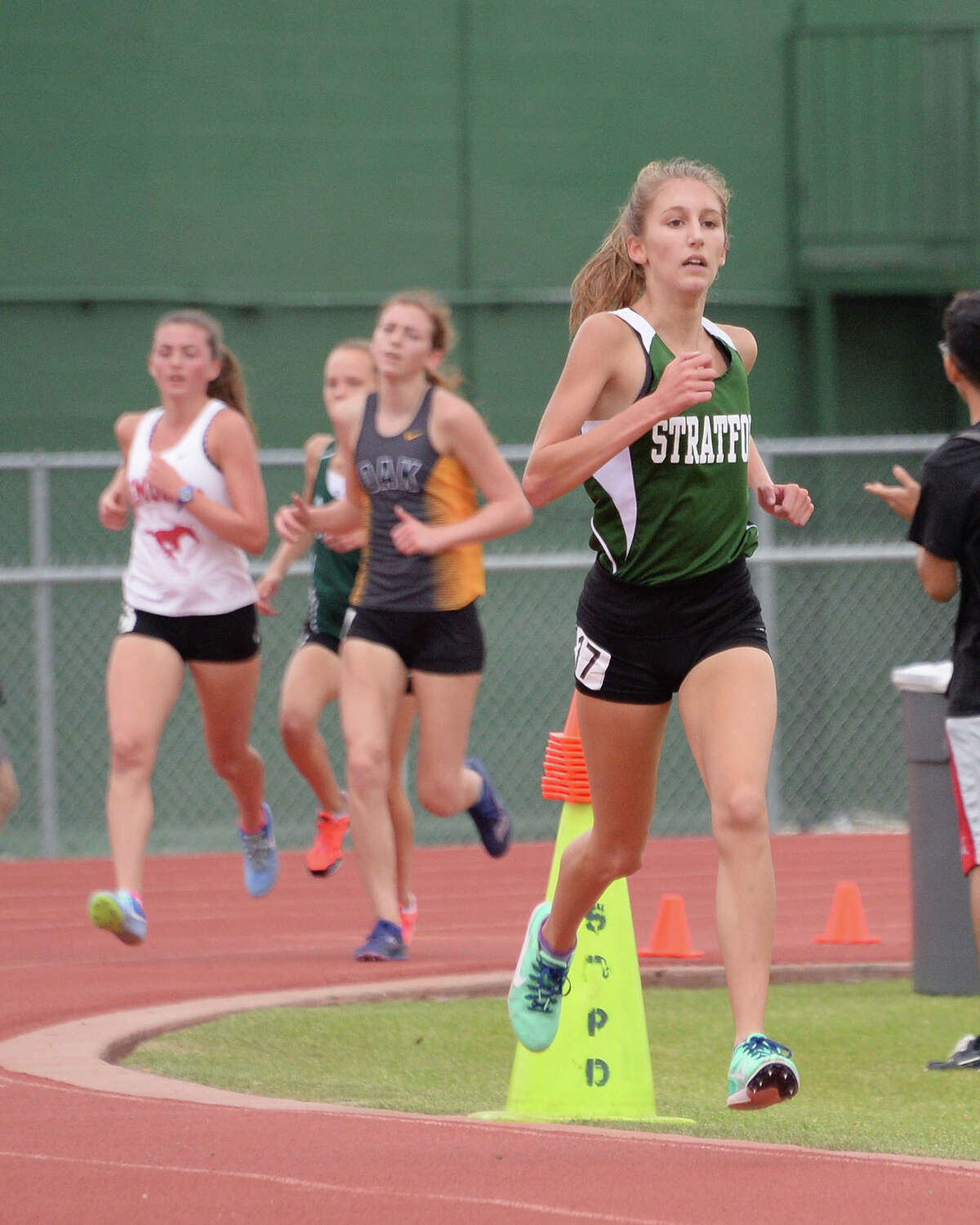 Grace Custer (17) of Stratford leads the pack and ultimately takes first place in the girls 3200 Meter event at the 15-6A Varsity District Track Meet on April 11, 2017 at Stratford High School, Houston, TX.