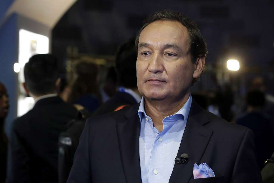 """FILE - In this Thursday, June 2, 2016, file photo, United Airlines CEO Oscar Munoz waits to be interviewed, in New York, during a presentation of the carrier's new Polaris service, a new business class product that will become available on trans-Atlantic flights. Munoz said in a note to employees Tuesday, April 11, 2017, that he continues to be disturbed by the incident Sunday night in Chicago, where a passenger was forcibly removed from a United Express flight. Munoz said he was committed to """"fix what's broken so this never happens again."""" (AP Photo/Richard Drew, File) Photo: Richard Drew, Associated Press"""