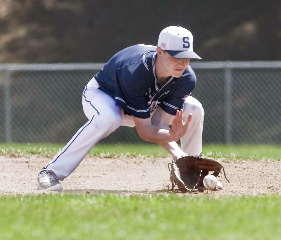 Staples High School second baseman Drew Rogers fields a ground ball in a game against Masuk High School, played at Masuk. Tuesday, April 11, 2017 Photo: Scott Mullin / For Hearst Connecticut Media / The News-Times Freelance